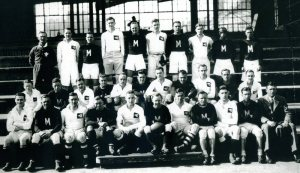 The U.S. Sixth Marine (black) based in Tientsin on the occasion of their spring 1928 visit to Shanghai (white) to play rugby. Coach Liversedge is sat on the front row, far right.