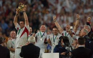 England's captain Martin Johnson holds up the Will