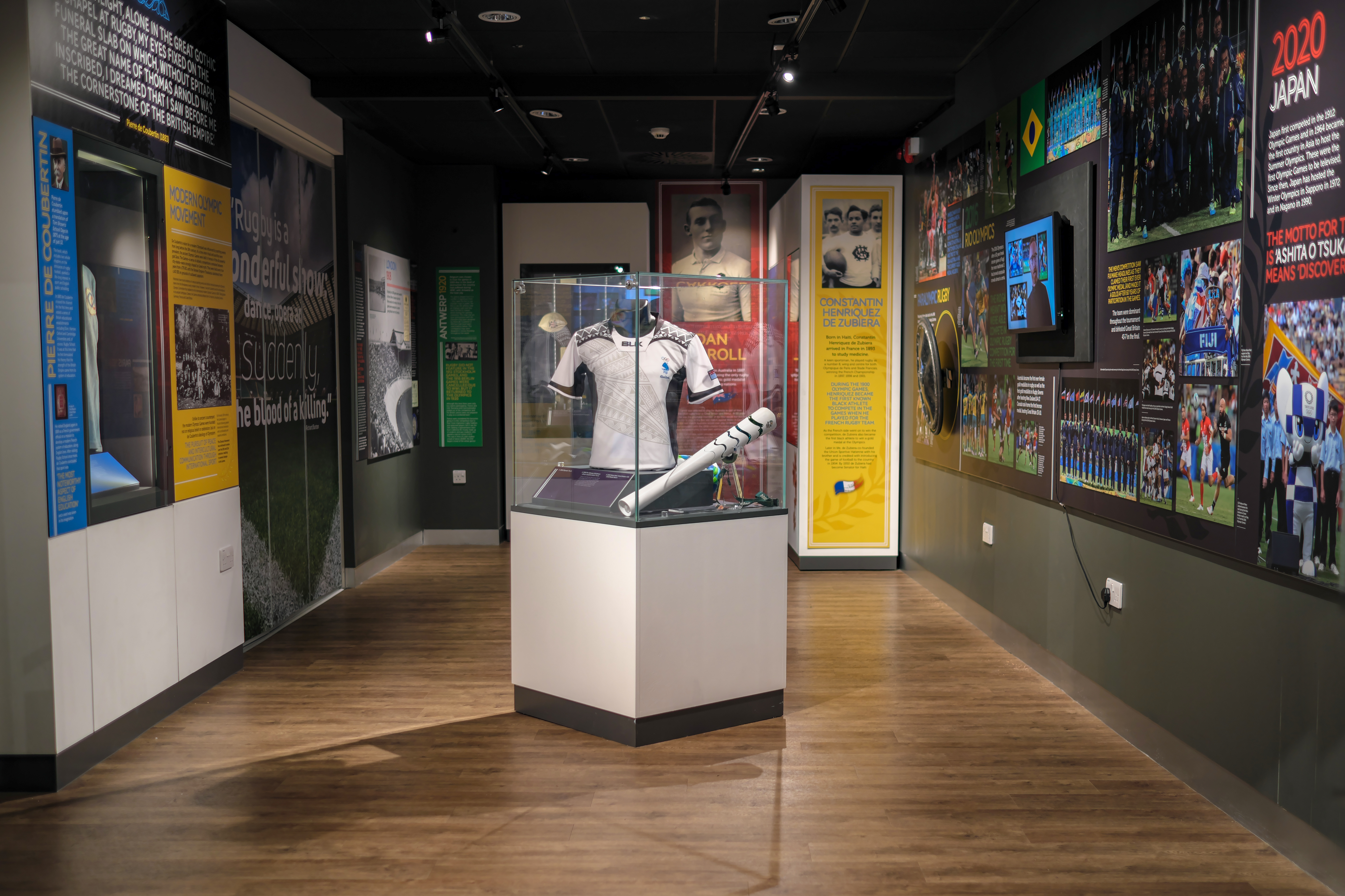 Rugby and the Olympics exhibition at the World Rugby Museum. Image of exhibition room with display cases.