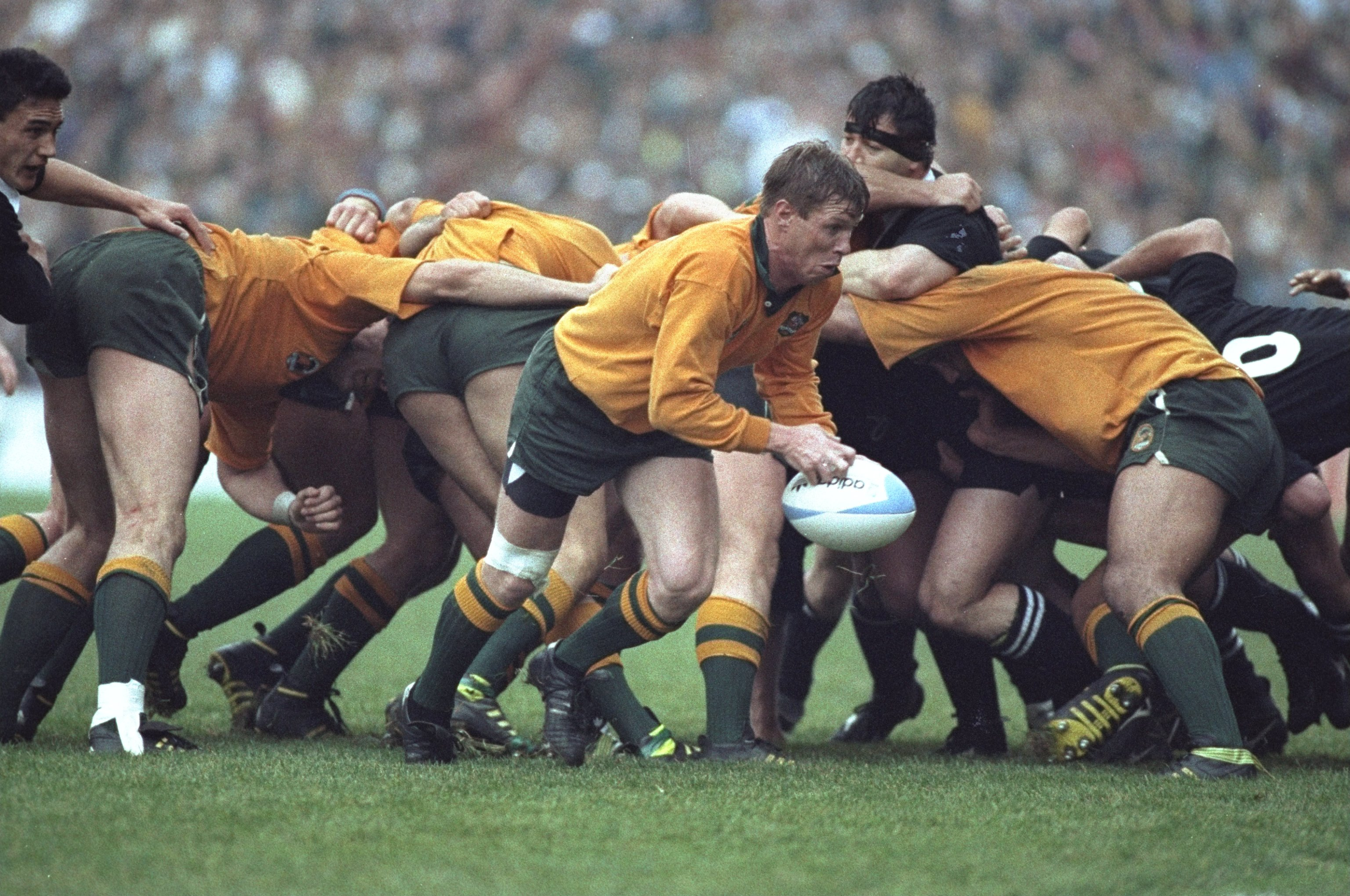Nick Farr-Jones of Australia with the ball in front of a scrum