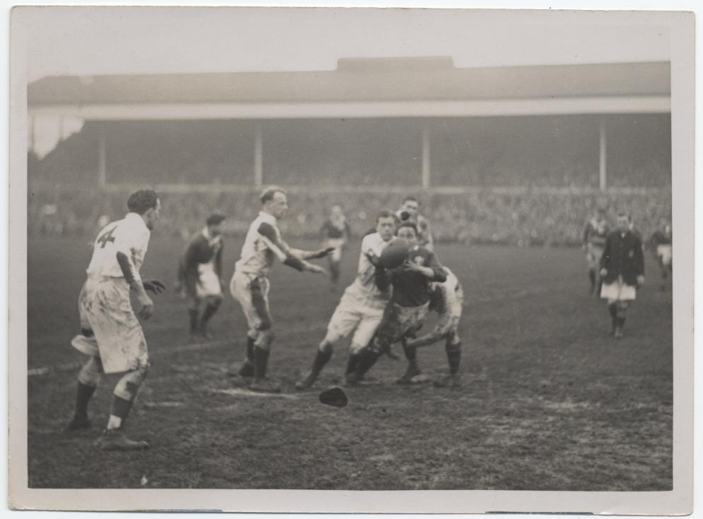 Black and white photograph of the match in action.