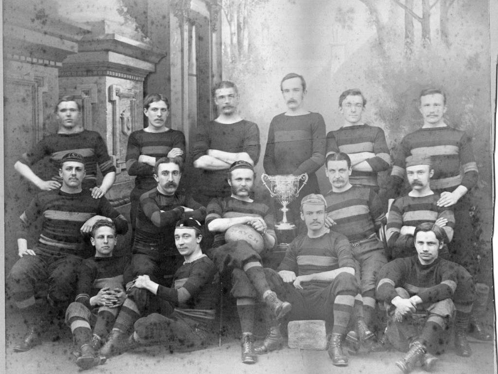 1881 Sunderland rugby team. 15 players seated and standing. Trophy in the middle.